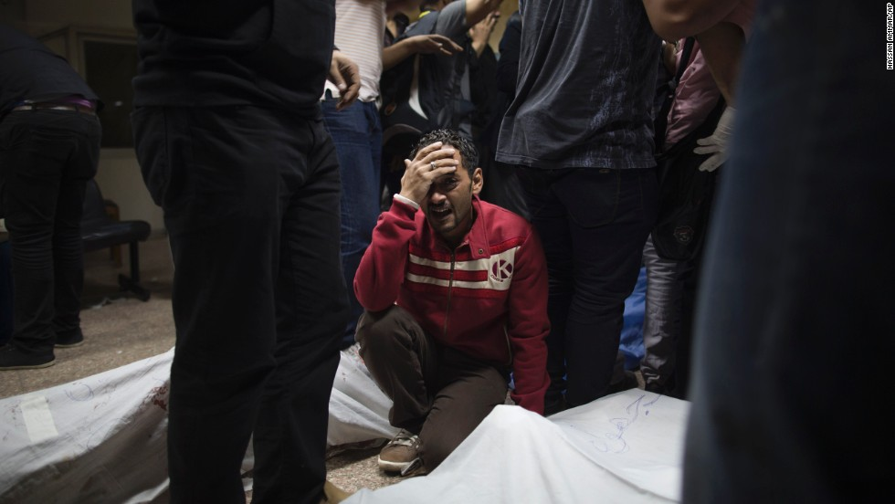 A Morsy supporter grieves for a relative killed during clashes with security forces on October 6 in Cairo.