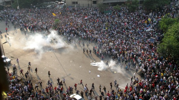 Morsy supporters run from tear gas along Ramsis Street in Cairo.