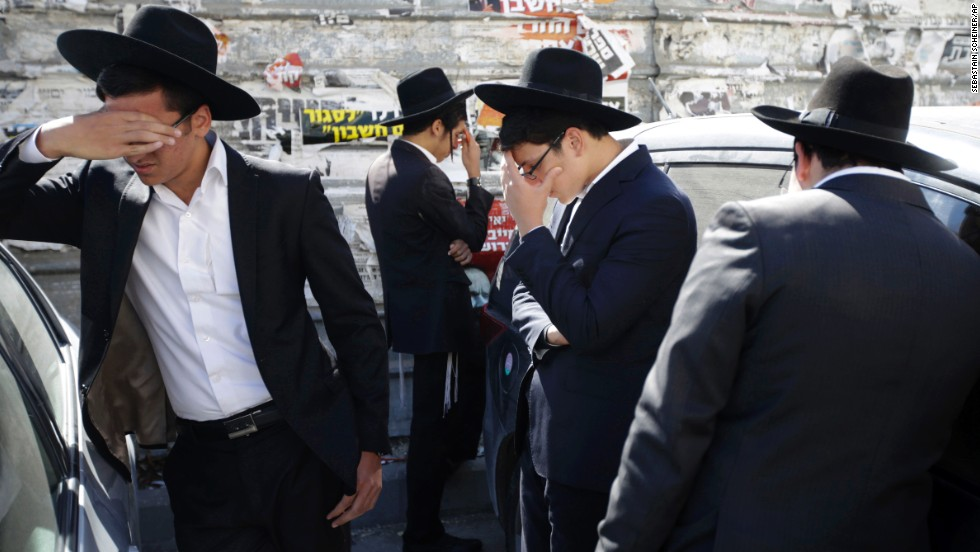 "Mourners gather outside the Jerusalem home of <a href=""http://www.cnn.com/2013/10/07/world/meast/israel-spiritual-leader-death/"">Rabbi Ovadia Yosef</a>, the former Sephardic chief rabbi of Israel, on Monday, October 7. Yosef, 93, died after medical complications from a stroke he suffered earlier this year. He was considered the leading authority in religious rulings in the realm of Jewish law and was a founder of the ultra-Orthodox Shas Party, playing a pivotal role in Israeli politics."