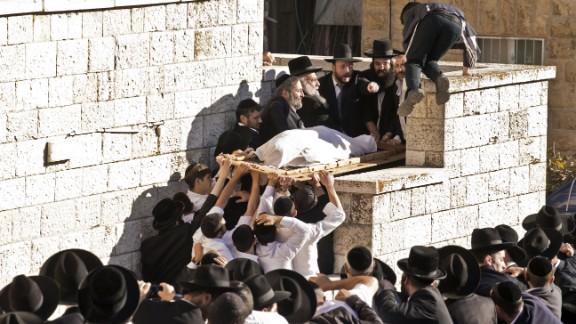 Yosef's body gets carried up stairs during the funeral procession.