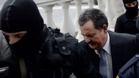 Greek Golden Dawn lawmaker Christos Pappas is escorted to a court in Athens on October 3, 2013. Pappas, the second most powerful figure in Greece's neo-Nazi Golden Dawn party was taken into custody after he was charged with helping to run a criminal organization.