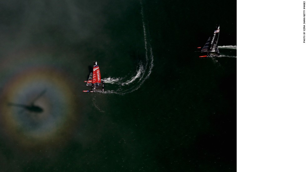 "Shaw flew in an open-door helicopter 400 meters above the waves to take his stunning images. ""The picture of the light reflecting against the fog created that rainbow halo. That was somewhat of a lucky picture and it's nice to get lucky like that some times,"" he said."