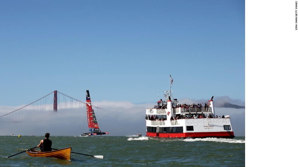 "Shaw added: ""This is one of my favorite images. Living in San Francisco, I always see the red and white ferry boat in the Bay when I come into the city and I like how the New Zealand boat is framed between the ferry, rowboat, and the foggy Golden Gate Bridge."""