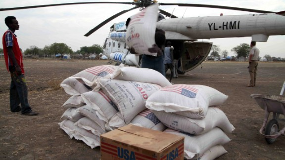 People in Jonglei state, South Sudan, unload aid from the U.N. World Food Program in January 2012.