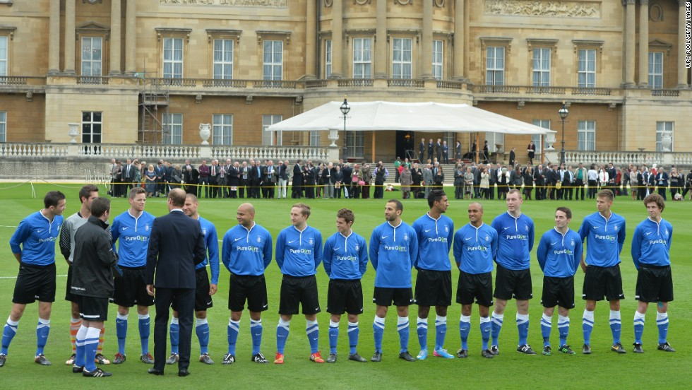 Prince William talks to the players ahead of the special match at Buckingham Palace to mark the 150th anniversary of the English FA.