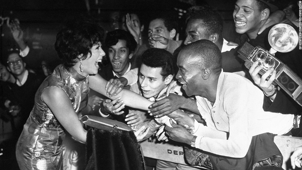 Moreno greets fans at the Rivoli Theater in New York in 1961.