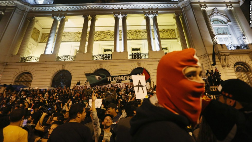 A masked man joins demonstrators in front of a government building during last October's protests in Rio.