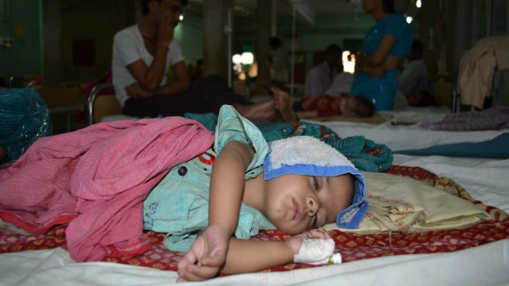 An Indian child with encephalitis lies on a bed at a medical college in Uttar Pradesh where hundreds of people have died from the disease this year.