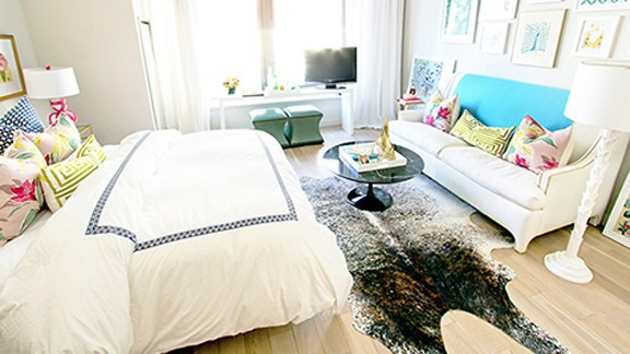 """<a href=""""http://ireport.cnn.com/docs/DOC-1040778"""">Jana Bek's</a> petite New York apartment is centered around a <a href=""""http://janabek.com/"""" target=""""_blank"""" target=""""_blank"""">brown spotted-hide rug</a>."""