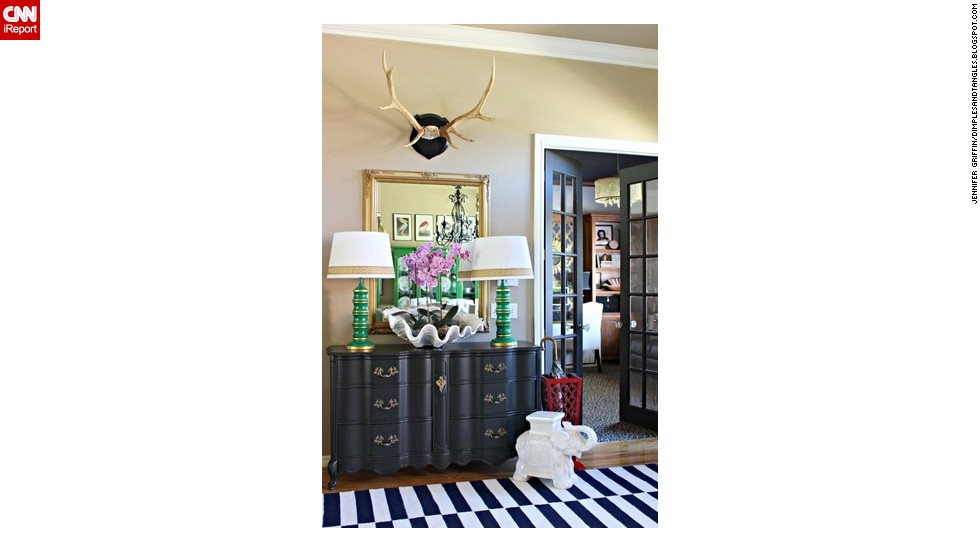 "<a href=""http://ireport.cnn.com/docs/DOC-1040813"">Jennifer Griffin's</a> entryway features <a href=""http://dimplesandtangles.blogspot.com/"" target=""_blank"">mounted antlers</a>, a seashell planter and a ceramic elephant."