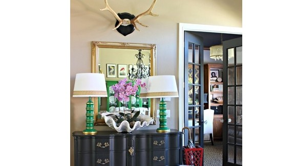 """<a href=""""http://ireport.cnn.com/docs/DOC-1040813"""">Jennifer Griffin's</a> entryway features <a href=""""http://dimplesandtangles.blogspot.com/"""" target=""""_blank"""" target=""""_blank"""">mounted antlers</a>, a seashell planter and a ceramic elephant."""
