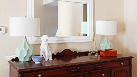 "<a href=""http://ireport.cnn.com/docs/DOC-1040611"">Chelsea McDonnough</a> adds <a href=""http://www.twotwentyone.net/"" target=""_blank"" target=""_blank"">sentimental decor</a> to an inherited buffet with this white ceramic dog figurine."