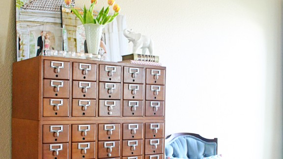 McDonnough loves elephants, and included a petite elephant planter to the top of her vintage library card catalog.