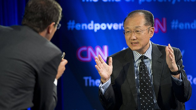 World Bank President Jim Yong Kim discusses plans to fight poverty during a seminar discussion with CNN's Richard Quest (L) at World Bank Headquarters during the annual World Bank - International Monetary Fund (IMF) meetings in Washington, DC, October 9, 2013. AFP PHOTO / Saul LOEBSAUL LOEB/AFP/Getty Images