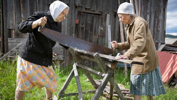 Sisters Aleftina and Ludmila Sablina are in their 70s, they continue to carry on with their traditional way of life in Alekhovshchina, a small Russian village. While most neighbors have upgraded to chainsaws, they continue to use a two-handed saw to cut wood which has been in the family for decades.