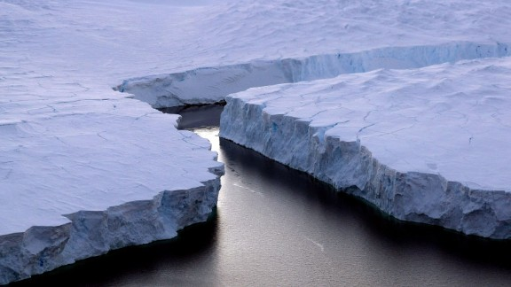 An enormous iceberg (R) breaks off the Knox Coast in the Australian Antarctic Territory on January 11, 2008. Australia