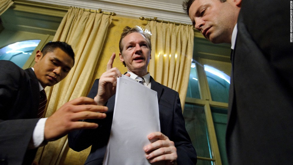 Assange and his bodyguards are seen after a news conference in Geneva, Switzerland, on November 4, 2010. It was the month WikiLeaks began releasing diplomatic cables from U.S. embassies.