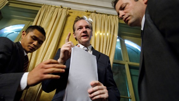 Assange and his bodyguards are seen after a news conference in Geneva, Switzerland, in November 2010. It was the month WikiLeaks began releasing diplomatic cables from US embassies.
