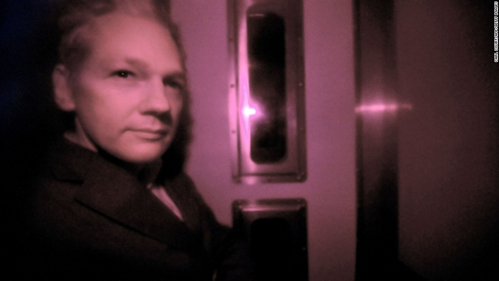 Assange sits behind the tinted window of a police vehicle in London on December 14, 2010. Assange had turned himself in to London authorities on December 7 and was released on bail and put on house arrest on December 16. In February 2011, a judge ruled in support of Assange's extradition to Sweden. Assange's lawyers filed an appeal.