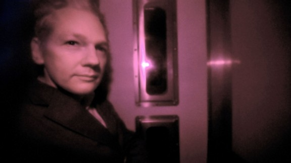 Assange sits behind the tinted window of a police vehicle in London on December 14, 2010. Assange had turned himself in to London authorities on December 7 and was released on bail and put on house arrest on December 16. In February 2011, a judge ruled in support of Assange