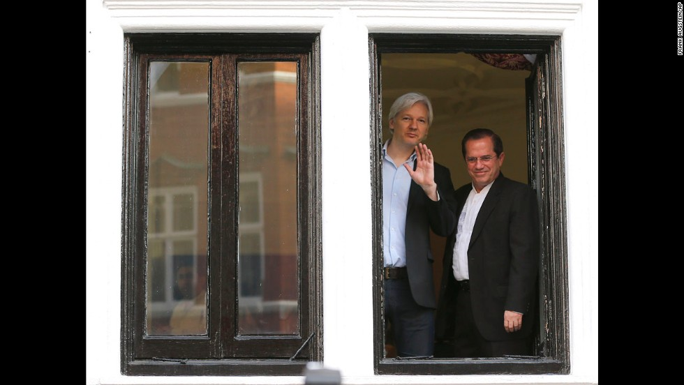 Assange appears with Ecuadorian Foreign Minister Ricardo Patino on the balcony of the embassy in June 2013.