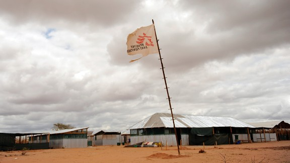 A flag bearing the logo of Medecins sans Frontieres (also known as Doctors Without Borders) stands in the middle of a makeshift clinic at Kenya