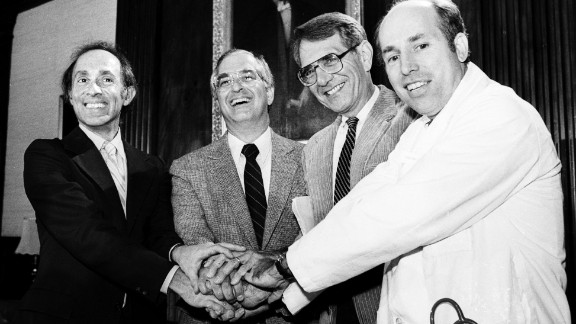 Members of the International Physicians for the Prevention of Nuclear War clasp hands on October 11, 1985, at the group