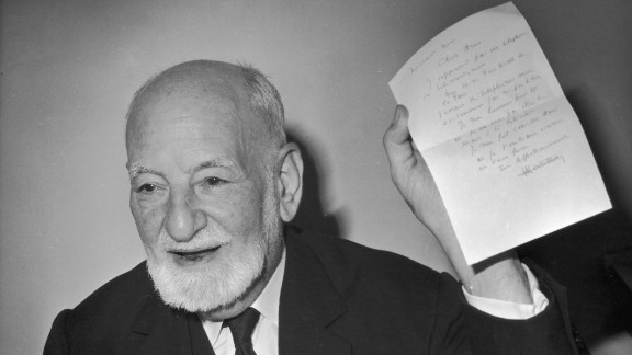 Rene Cassin, the French jurist and a deputy chairman of the NATO committee for human rights, holds up a telegram after being notified of winning the Nobel Peace Prize in 1968.