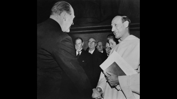 Georges Pire, right, receives the Nobel Peace Prize in 1958 for his efforts to help European refugees leave their camps and return to a life of freedom and dignity.