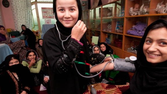 Soliha practises measuring blood pressure in an Afghan Turk clinic in Taloqan, north of Afghanistan. Along with a class of 20 young village women, she spends 18 months training to become a midwife. After qualifying, they return to their remote villages. In a country whose child mortality rates are the highest in the world and where many women die in pregnancy, their skills will save lives and enable women to deliver babies safely.