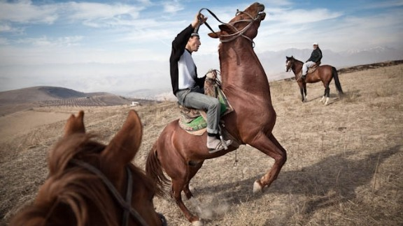 Suhrob exercises one of the horses in preparation for Buzkashi -- a Central Asian sport where up to a hundred or more riders fight to seize a headless goat carcass then carry it to a goal. As is common in the buzkashi world, rather than riding their own horses, Suhrob and his brothers ride animals owned by a wealthy individual.
