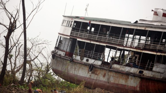 The shell of a ferry is dumped on land in Bogale by fierce winds and waves whipped by Cyclone Nargis, in a photo dated May 18, 2008. Around 140,000 people were killed across Myanmar in the country