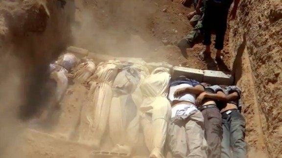 An image grab taken from a video uploaded on YouTube by the Local Committee of Arbeen on August 21, 2013 allegedly shows Syrians covering a mass grave containing bodies of victims that Syrian rebels claim were killed in a toxic gas attack by pro-government forces in eastern Ghouta and Zamalka, on the outskirts of Damascus. The allegation of chemical weapons being used in the heavily-populated areas came on the second day of a mission to Syria by UN inspectors, but the claim, which could not be independently verified, was vehemently denied by the Syrian authorities, who said it was intended to hinder the mission of UN chemical weapons inspectors. AFP PHOTO / YOUTUBE / LOCAL COMMITTEE OF ARBEEN== RESTRICTED TO EDITORIAL USE - MANDATORY CREDIT