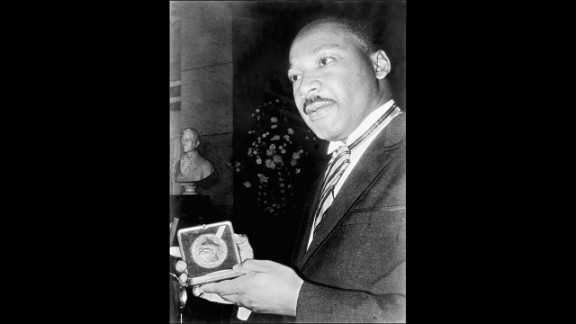 The Rev. Martin Luther King Jr. displays his Nobel Peace Prize medal in December 1964 in Oslo, Norway. Then 35, King was the youngest man to have received the prize. The U.S. civil rights leader was slain in 1968.