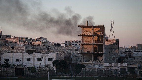 Smoke rises after a mortar shell hit a residential area during fighting between Syrian government forces and rebels in Maaret al-Numan, Syria, on October, 9.