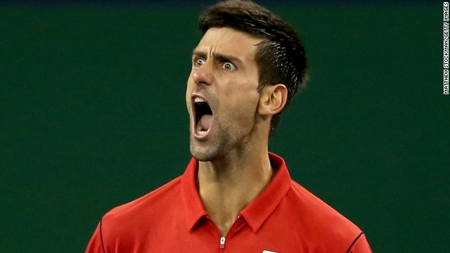 Novak Djokovic strikes a typical pose after closing out Gael Monfils in their Shanghai Masters quarterfinal.