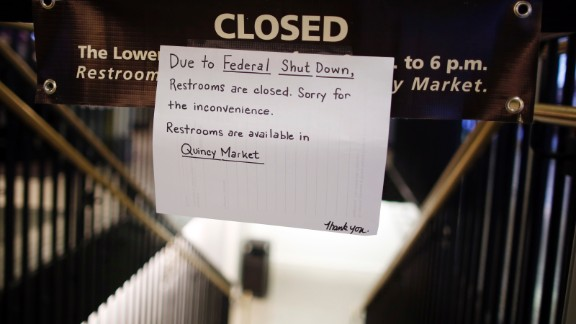 A sign at the bathroom of the National Visitors Center in Boston announces that the restrooms are closed in Faneuil Hall.