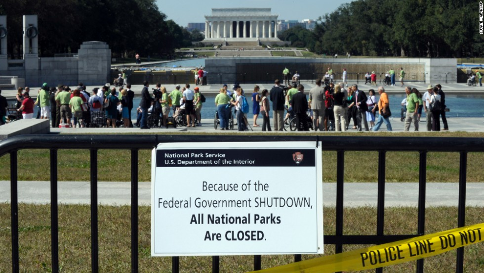 Despite signs stating that the national parks are closed, people visit the World War II Memorial in Washington on October 2.