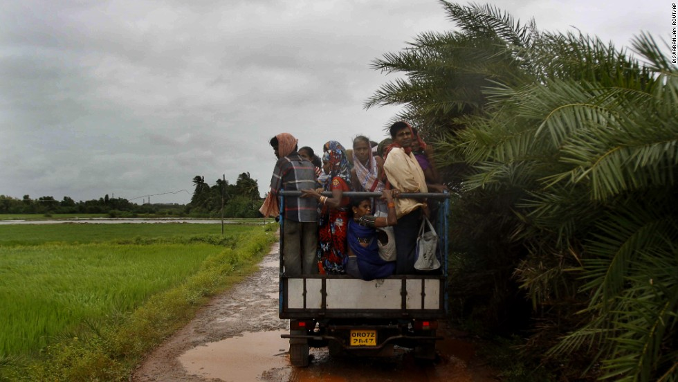 A small truck takes villagers to a cyclone shelter in Podampeta on October 12.