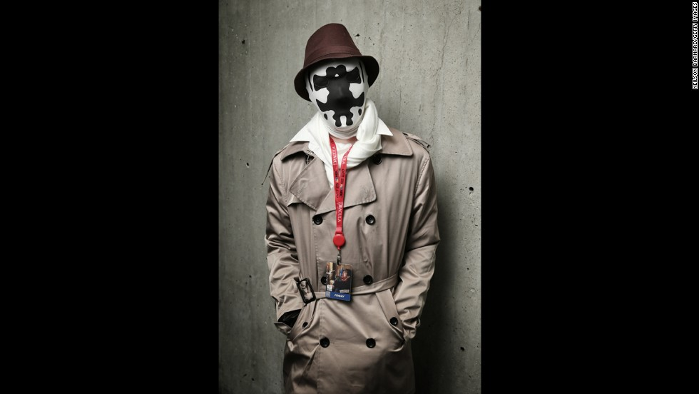 "An attendee stands as the masked vigilante, Rorschach from the graphic novel ""Watchmen."""