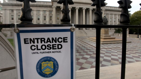 A closed sign hangs at the entrance to the U.S. Treasury building October 3.