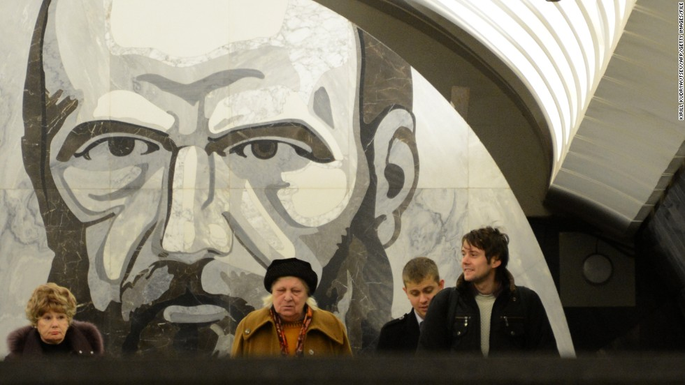 Passengers wait at the Dostoyevskaya metro station in Moscow. Much of the Russian capital's vast underground system is decorated with elaborate Soviet artwork. Here, a portrait of iconic author, Fyodor Dostoyevsky, looks down upon travelers.