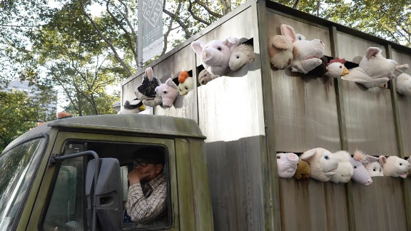 "Banksy's ""Sirens of the Lambs"" art installation tours the streets of Manhattan in October 2013. It was a fake slaughterhouse delivery truck full of stuffed animals."
