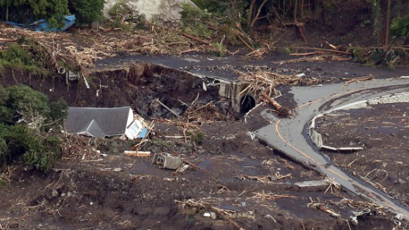 Houses were crushed and roads blocked, killing at least 17.