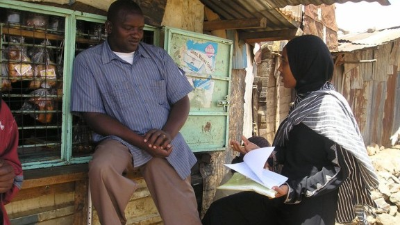 """His organization """"Pambazuko Mashinani"""" has a variety of social change programs in reproductive health, women's empowerment and youth outreach. Pictured, one of the group's volunteers conducts a field interview surveying people about tuberculosis."""