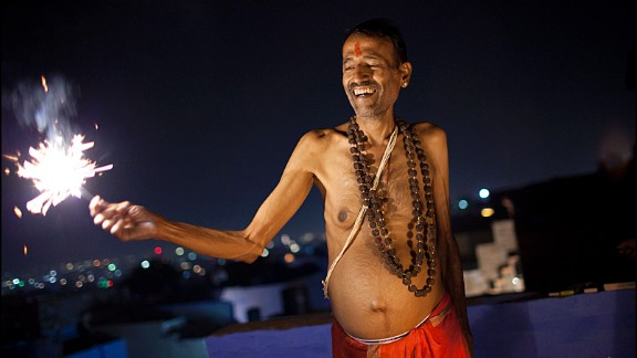 """Roy del Vecchio from the Netherlands was traveling through India during Diwali. """"I love India and wanted to experience the festival once in Rajasthan. This man invited me for sweets, a tradition during Diwali, and together with his sons we lit some fireworks on the rooftop,"""" said the 39-year-old."""