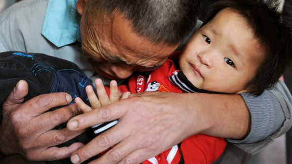 Wang Bangyin breaks down as he hugs his rescued son at a welfare center for children in China