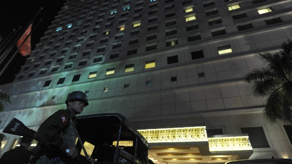 A soldier stands guard outside the Traders Hotel in Yangon on October 14 after it was rattled by a bomb.