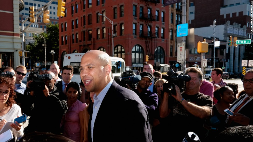 Booker greets people in Hoboken, New Jersey, after winning the Democratic primary on August 14.