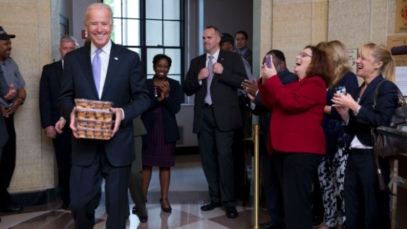 Vice President Joe Biden greets Environmental Protection Agency workers with muffins at the Clinton Federal Building in Washington as they return to work October 17.
